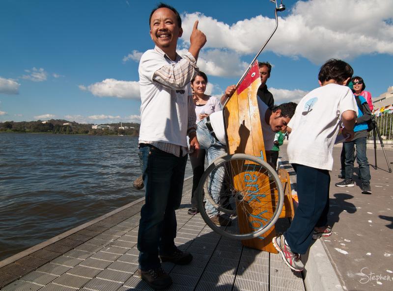 Tri Nguyen with Gift of Refuge model refugee boat