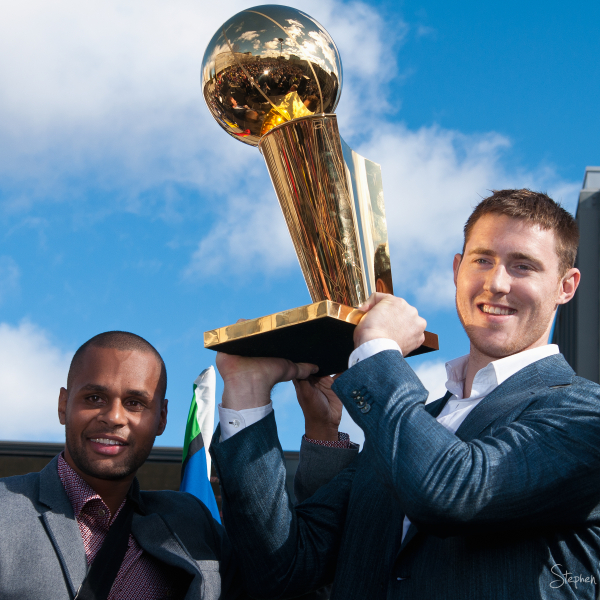 Patty Mills with the Larry O'Brien trophy