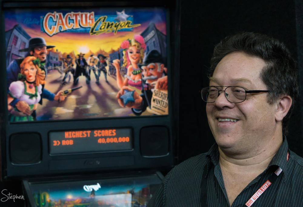 Jose at pinball arcade at Big Boys Toys expo