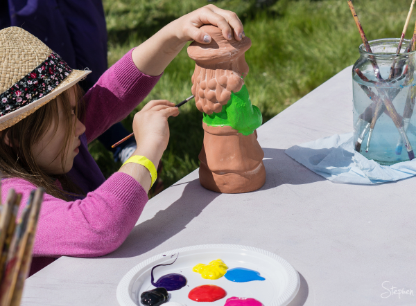 Painting gnomes at Gnome Knoll during Floriade