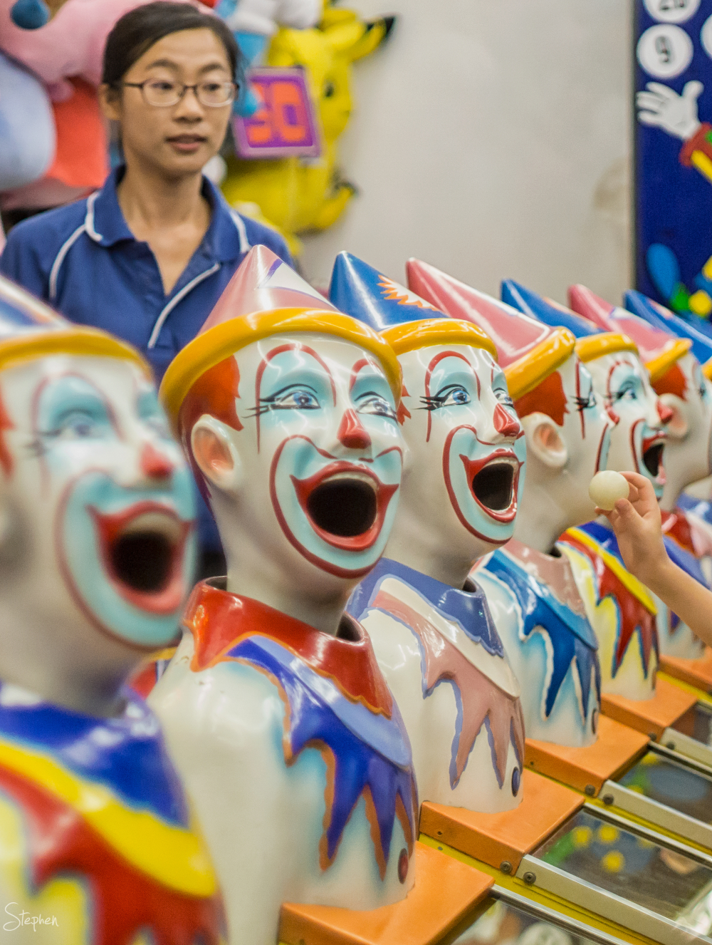 Laughing clowns in sideshow alley at Canberra Show
