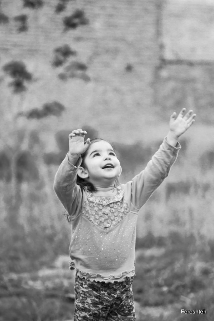 Greetings from Mashhed, Iran  :)  My God ! ...... This photo was taken Mashhed  Iran. she`s my niece holding up her hands looking at sky. I thought for a moment she was talking to God.  That is why I took the photo.