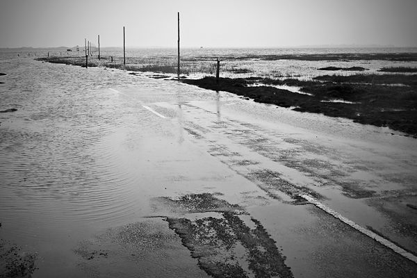 way to holy island in high tide during rain
