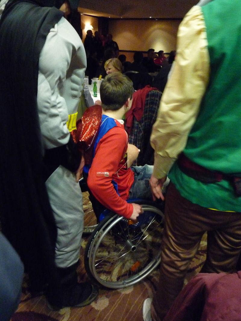 Wonder woman being pushed by Batman