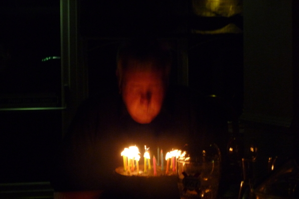 Peter blowing his candles out