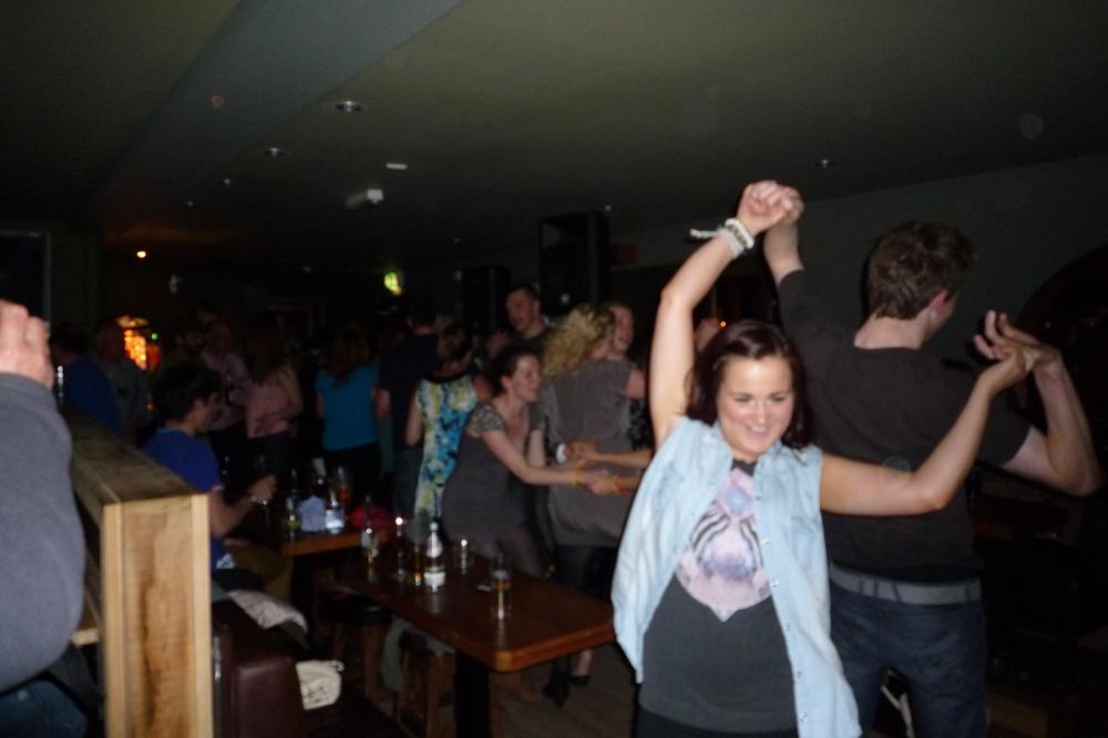 Ceilidh dancing in pub