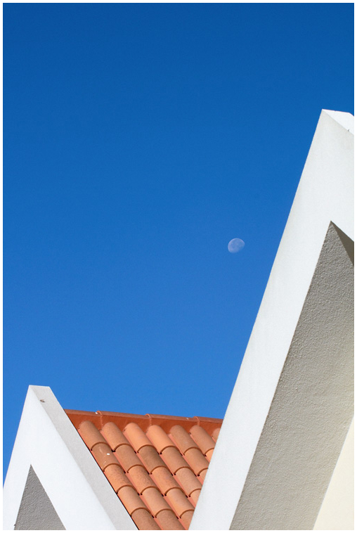 Moon above the roof