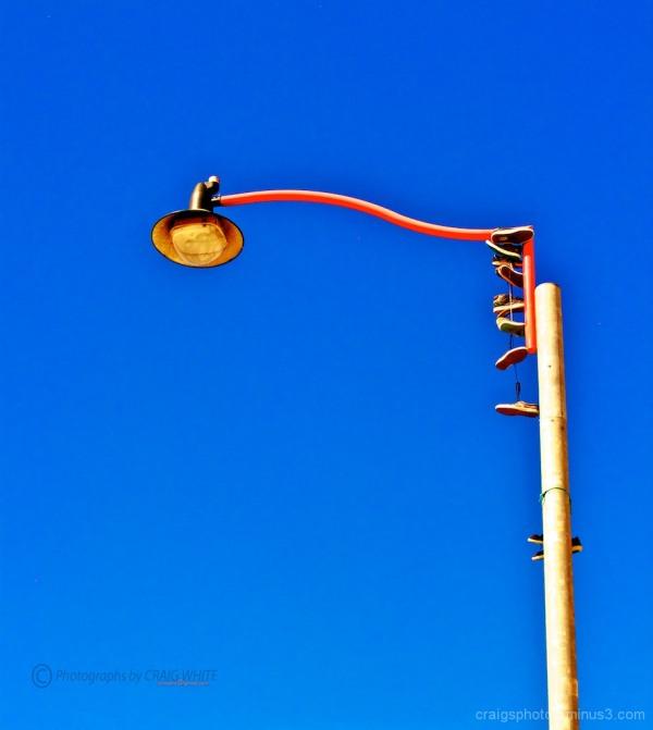 Light pole against vivid blue sky