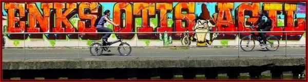 Le  canal de l'ourcq, murs peints et cyclistes.