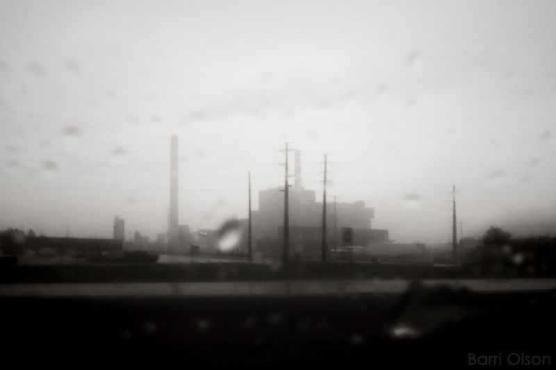 Cell Phone Photo of factory in the rain