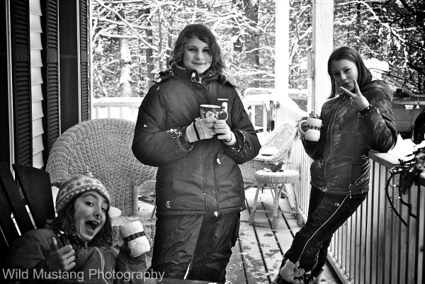 Girls    porch     snow