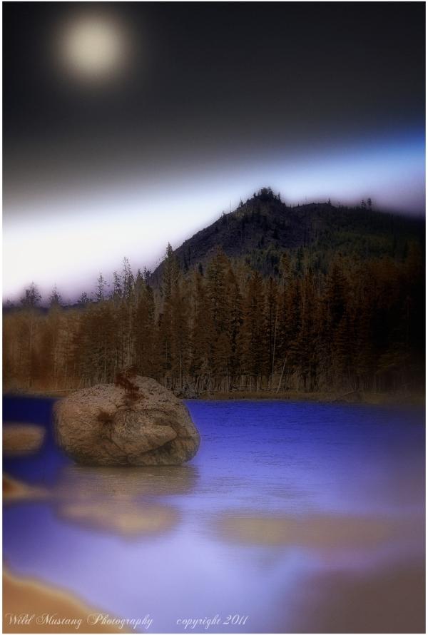 River   trees rocks mountains