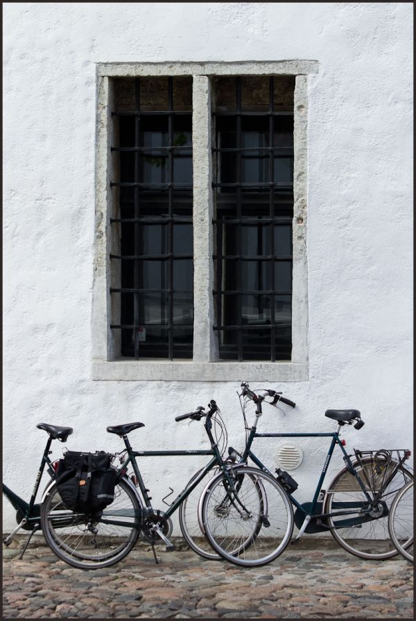bicycles by the church window