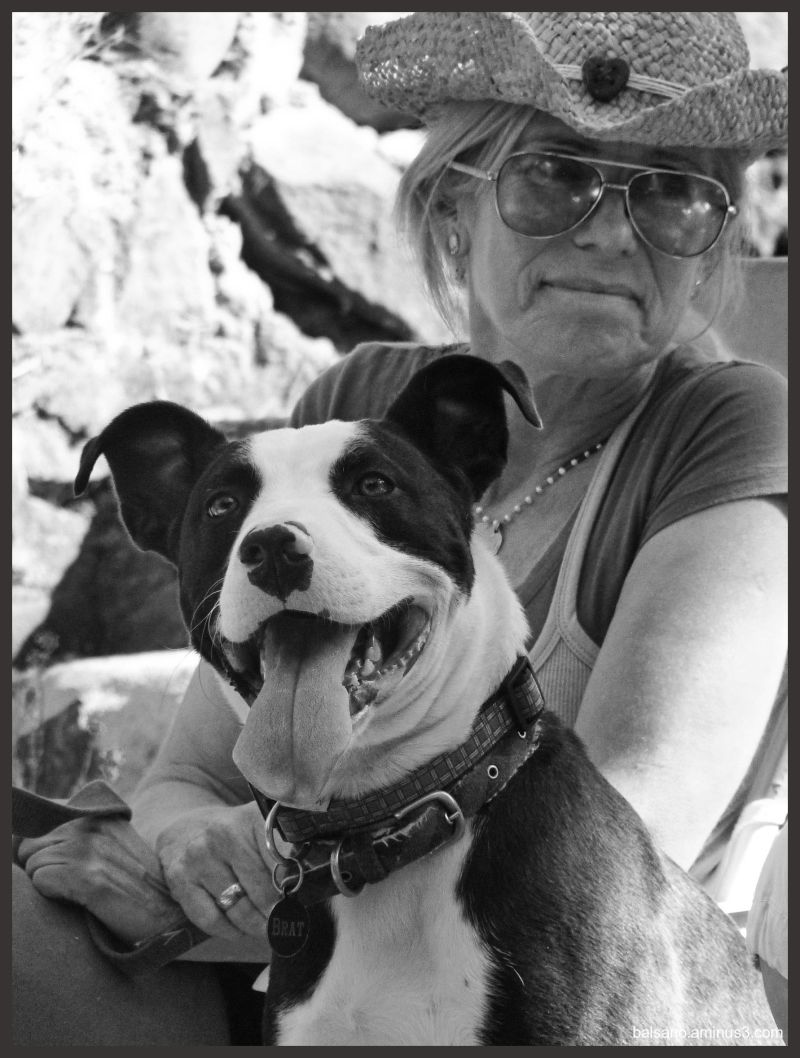 a heart on her hat and a doggie named BRAT