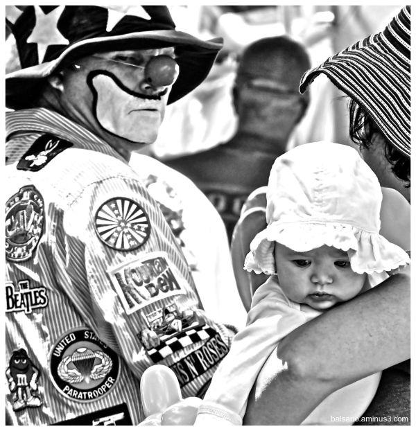 clowns, babies, mothers, men all wear hats ~ 5
