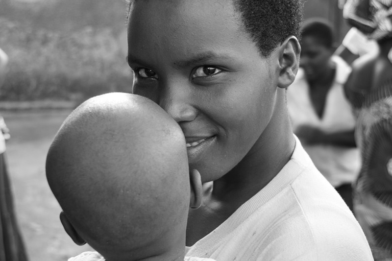 Young Burundian mother with child
