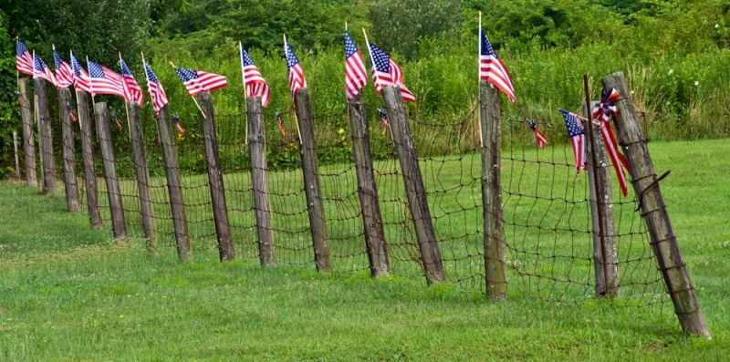 Flag lined fence in Franklin, Connecticut