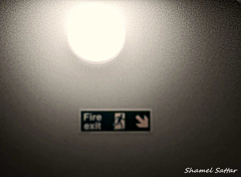 Lamp by a fire exit