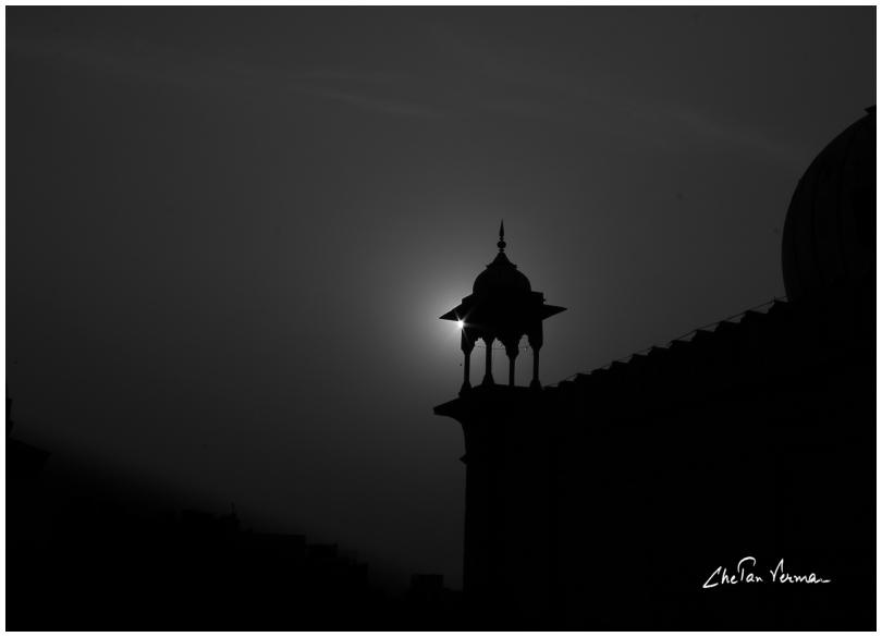 A minar against the sun