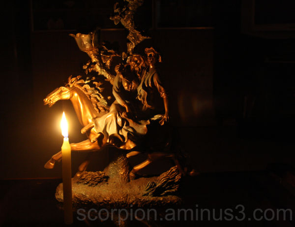 A miniature statue - lit by candle...