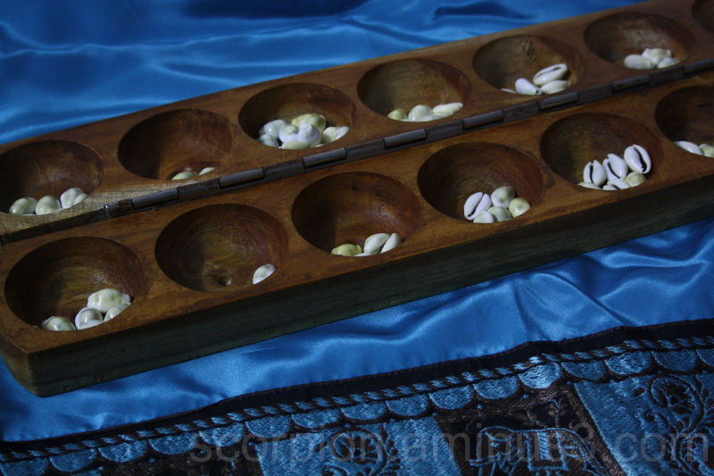 """Pallanguzhi""  - a South Indian indoor game"
