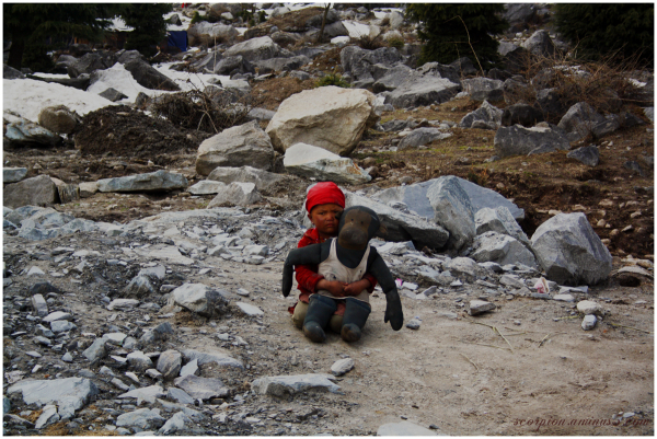 Lone Child at the foothills of Himalayas