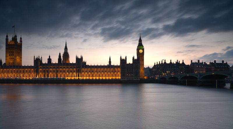 Floodlit Houses of Parliament and Thames at dusk