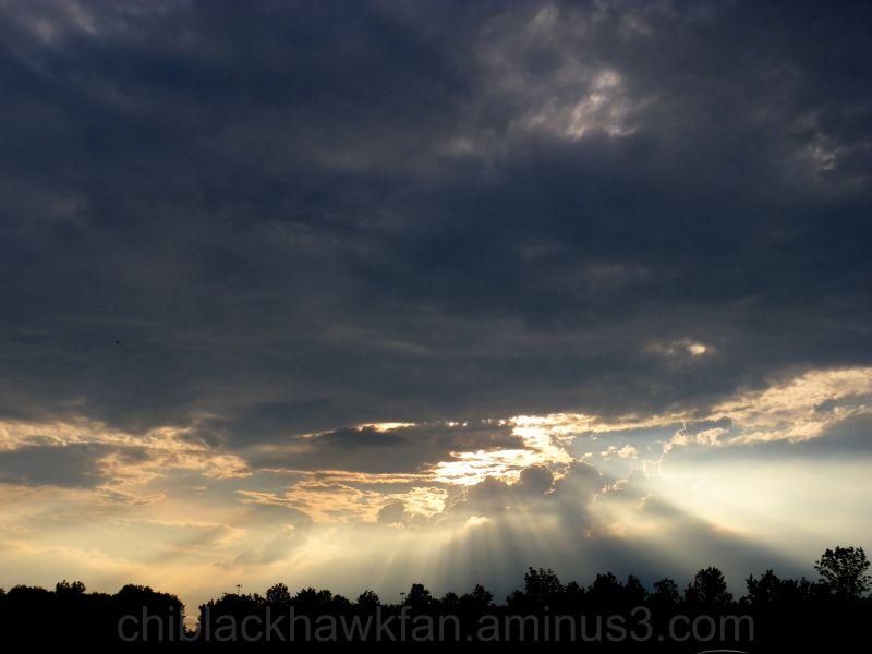 Sun Rays Through Storm At Sunset