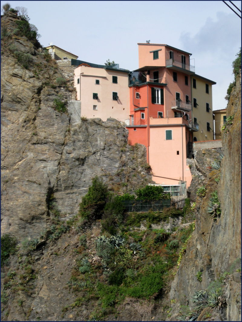 houses on a cliff top in Manarola Italy