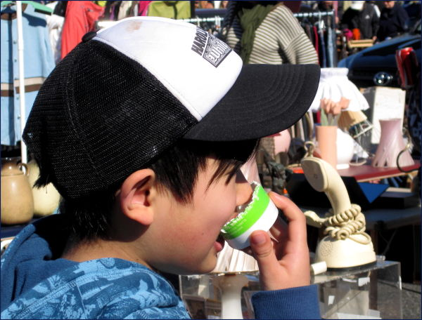 a boy eating a cup
