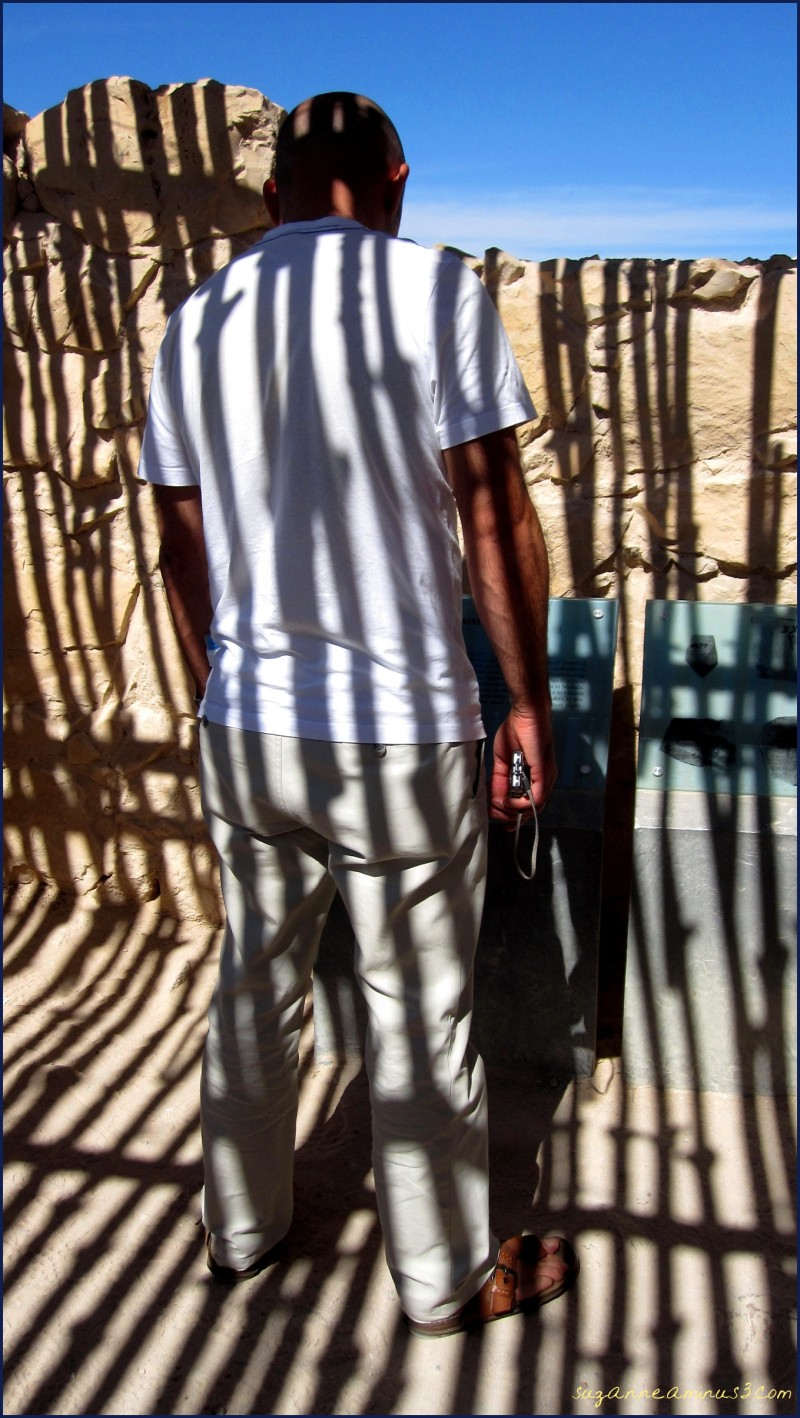man with roof shadows on him