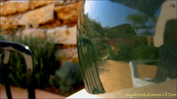 reflections on a ceramic pot surface