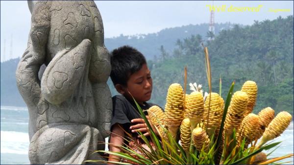 boy resting after work; lombok