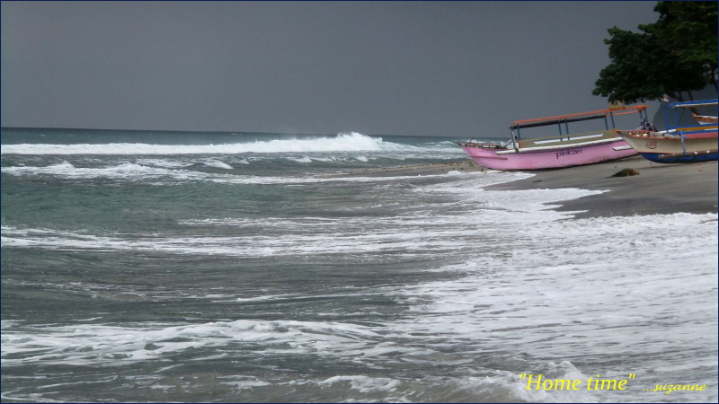 Fishing boats Lombok Village; storm brewing