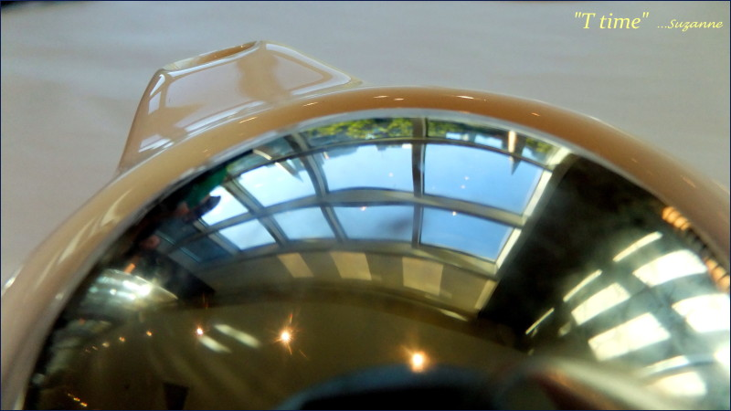 tea pot with city reflections