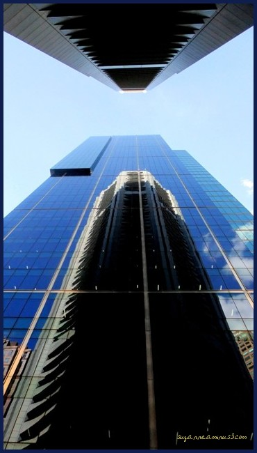 city buildings,upwards, one reflected,