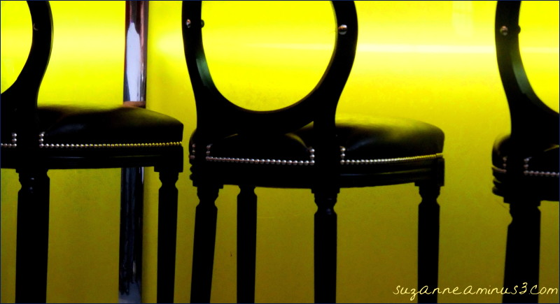 an image of chairs in front yellow glass