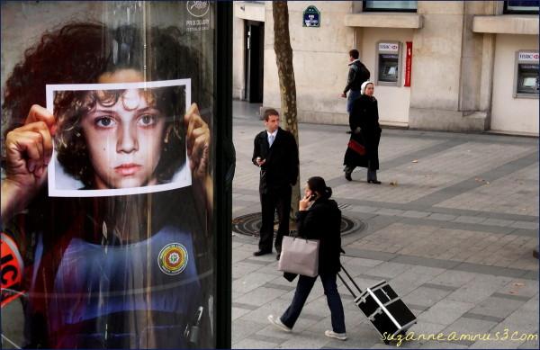 image, advert, face, street, people, walking, past