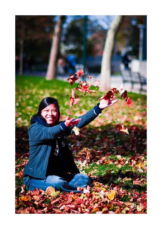 phi throwing leaves, philadelphia, fall 2010