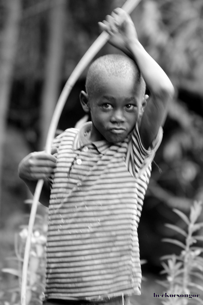 Boy is playing with a stick.