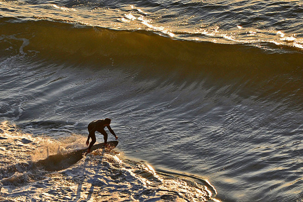 Surfing at late afternoon