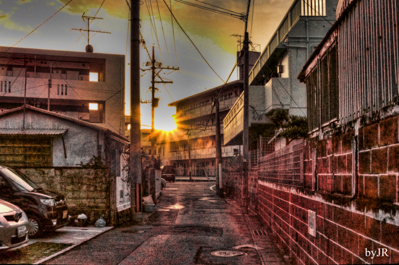 Sunrise down a narrow street.