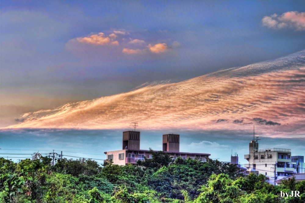 Awesome clouds over okinawan city.