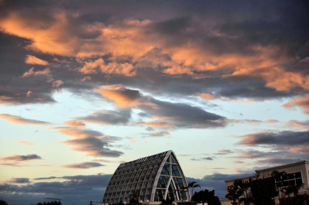 Nice sky over a glass chapel.