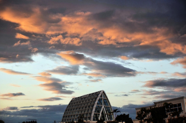 Nice sky over a glass chapel.