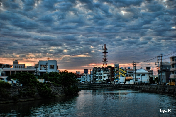 Sunset on the river in Urasoe City.