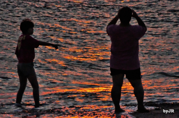 Taking pictures at sunset.