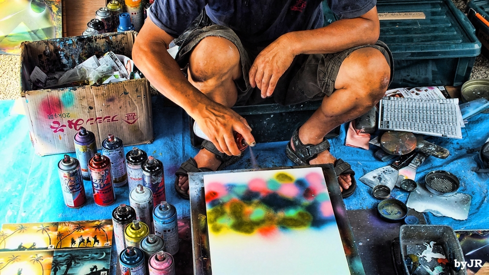 A spray paint artist at work.