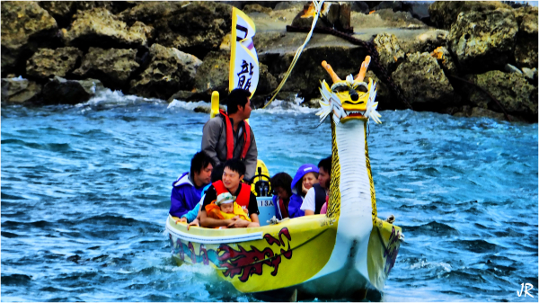 Some tourist ride in a glass bottomed dragon boat.