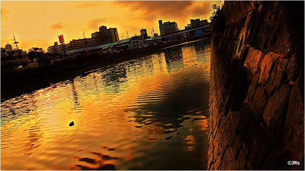 A golden sky over the river.